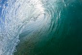 stock photo of hollow  - Swimming surfing view inside  hollow tube wave crashing closeup in shape energy power detail - JPG