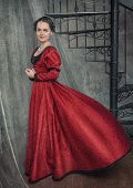 image of flutter  - Beautiful young woman in red fluttering medieval dress