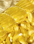 foto of silk worm  - Yellow silk thread and cocoon the material for silk cloth - JPG