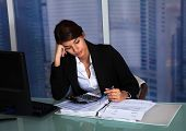 pic of late 20s  - Stressed young businesswoman working at computer desk in office - JPG