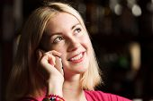 pic of handphone  - Young attractive lady at bar talking on phone - JPG