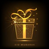 image of ramazan mubarak card  - Shiny golden gift box with ribbon on brown background for muslim community festival Eid Mubarak celebrations - JPG