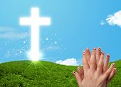 foto of fingers crossed  - Happy finger smiley faces on hand with christian religion cross - JPG