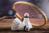 image of shuttlecock  - A set of badminton. Paddle and the shuttlecock. Studio shot