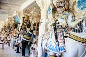 stock photo of hindu-god  - Ancient stone curved sculptures of Hindu Gods and godess - JPG