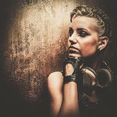 foto of post-apocalypse  - Attractive steampunk girl with headphones - JPG