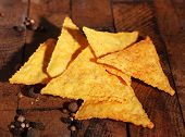 picture of nachos  - Tasty nachos on wooden background - JPG