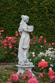 foto of garden sculpture  - This is the beautiful rose garden with a sensual woman sculpture which belongs to the castle of Arcen - JPG