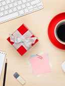 pic of office romance  - Red gift box on office table - JPG