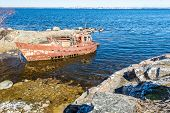 foto of shipwreck  - Two rusty shipwrecks in the Blekinge coast of Sweden with the town of Karlskrona in background - JPG