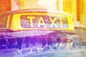 stock photo of cabs  - Taxi Cab Car Roof Sign Close Up with selective focus Double Exposure - JPG