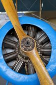 image of propeller plane  - Old aircraft engine with wood propeller vintage plane close up - JPG