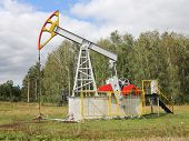 foto of nod  - The Oil pumpjack a Oil industry equipment - JPG