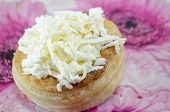 picture of decoupage  - Homebaked puff pastry with cheese on decorated plate [[** Note: Shallow depth of field ** Note: Visible grain at 100%, best at smaller sizes - JPG