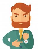 foto of angry  - A hipster Caucasian businessman with beard is angry pointing his wristwatch inside the office - JPG