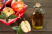 stock photo of cider apples  - Apple cider vinegar with a fresh apple - JPG