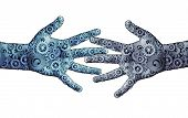 stock photo of robotics  - Working business teamwork concept as a group og mechanical gears and cog wheels shaped as two human open hands as a symbol for cooperation technology partnership or robotic artificial intelligence icon - JPG