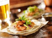 image of tacos  - spicy shrimp avocado tacos in slanted composition - JPG