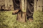 picture of shovel  - Details of feet and Shovel in front of Barn - JPG