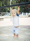 stock photo of pull up  - Baby hanging on a pull - JPG