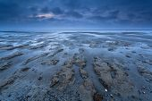 stock photo of tide  - coast texture at low tide on North sea Netherlands - JPG