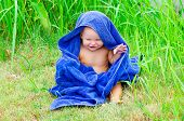 pic of naked children  - Little child sitting on the grass with blue towel - JPG