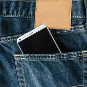 picture of denim jeans  - blue denim Jeans pocket with mobile phone - JPG