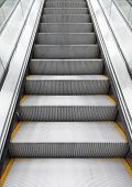 pic of escalator  - Shining metal escalator moving up vertical photo with perspective effect - JPG