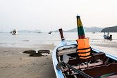 stock photo of tide  - Close up a blue wooden boat on the beach during low tide - JPG