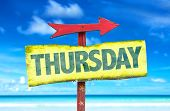 foto of thursday  - Thursday sign with beach background - JPG