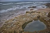 image of tide  - Low tide leaves outdoors a rocky area that is normally under water - JPG