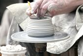 image of molding clay  - The potter during a jug molding .Close up ** Note: Shallow depth of field - JPG
