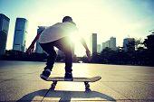 foto of skateboarding  - woman skateboarder legs skateboarding at sunrise city - JPG