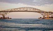 stock photo of cross  - The twin spans of the Blue Water Bridges crossing between Sarnia - JPG