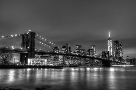 foto of bridge  - Brooklyn bridge and New York City Manhattan downtown skyline at dusk with skyscrapers illuminated over East River panorama - JPG