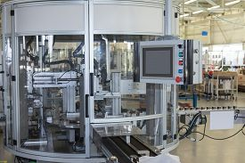 picture of production  - Front view of the automatic production line with a control panel - JPG