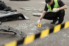 stock photo of accident victim  - Policeman during investigation at road accident area - JPG