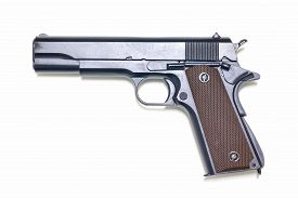 foto of pistols  - Old pistol in 1911 isolated on white background - JPG