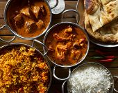 assorted indian curry and rice dishes in flat lay composition poster