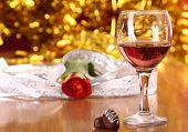 picture of valentine candy  - christmass dinner with rose candies and glass of red wine - JPG