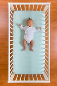 the top view of baby in cot