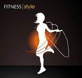 picture of gym workout  - girl jumping with the skipping rope  - JPG