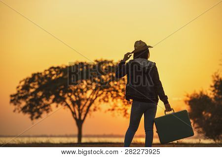 poster of Independent Travel.young Woman Traveler With A Luggage