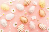 Flat Lay Of Golden Easter Eggs Pattern With Small Flowers And Petals On Pink Background. Easter Back poster