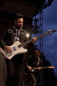 CLARK, NJ - SEPT 17: Bass guitar player Branden Campbell of the band Neon Trees performs at the Unio