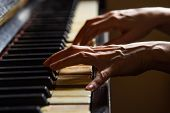 Close Up Fingers Of Woman Pianist At The Rusty Piano Keys, Arms Plays Solo Of Music. Hands Of Female poster