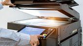 Business Man Hand Press Button On Panel Of Printer, Printer Scanner Laser Office Copy Machine Suppli poster