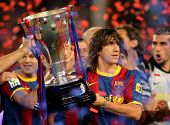 BARCELONA - MAY 15: Carles Puyol of FC Barcelona holds the La Liga trophy after the match between Ba