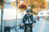 Hipster Businessman Commuter With Electric Bicycle Traveling Home From Work In City. poster