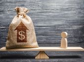 Money Bag With Up Arrow And Man Figurine On Scales. Criteria And Requirements For Increasing The Wor poster